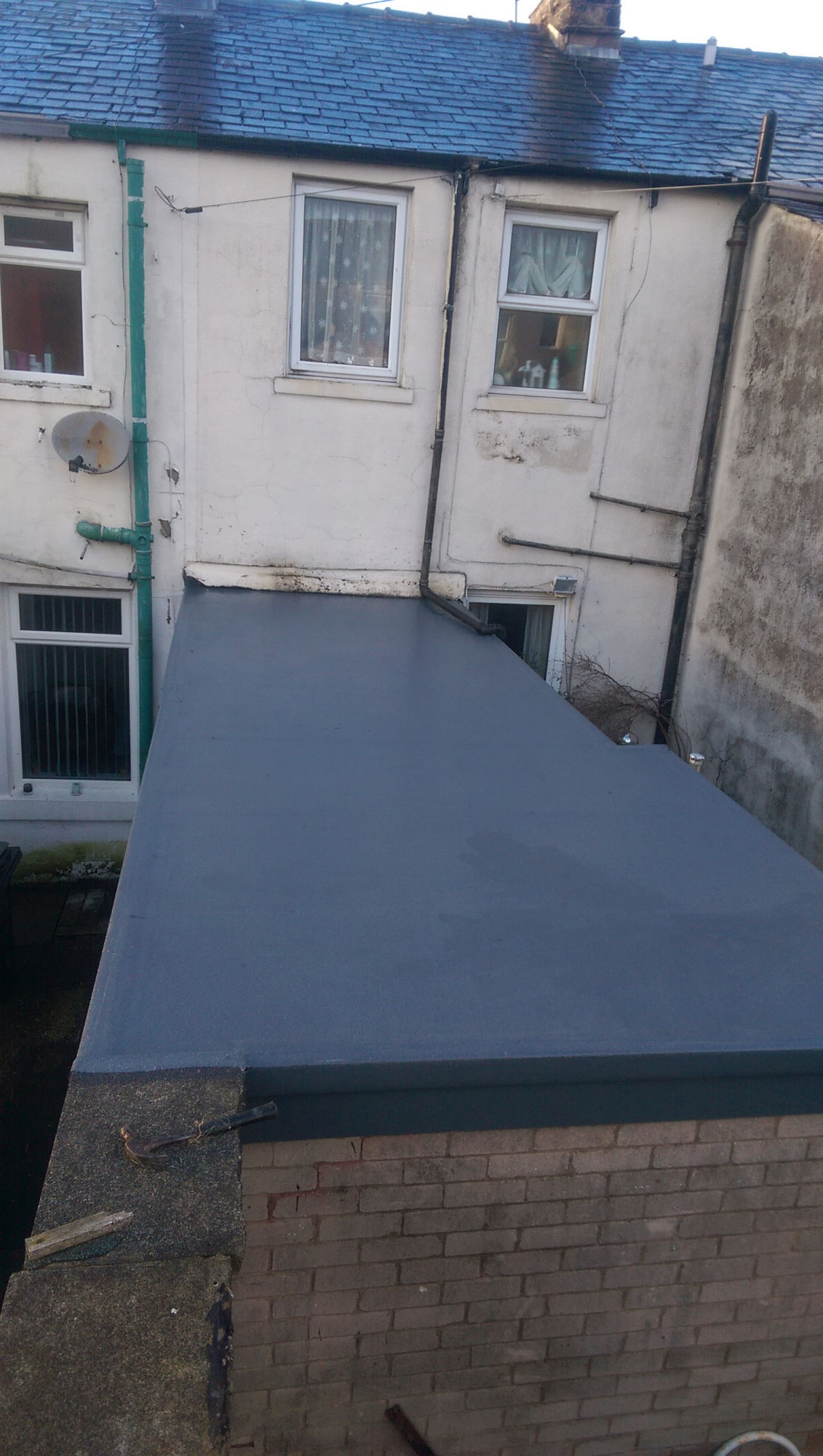 Kitchen extension flat roof repair in Nelson