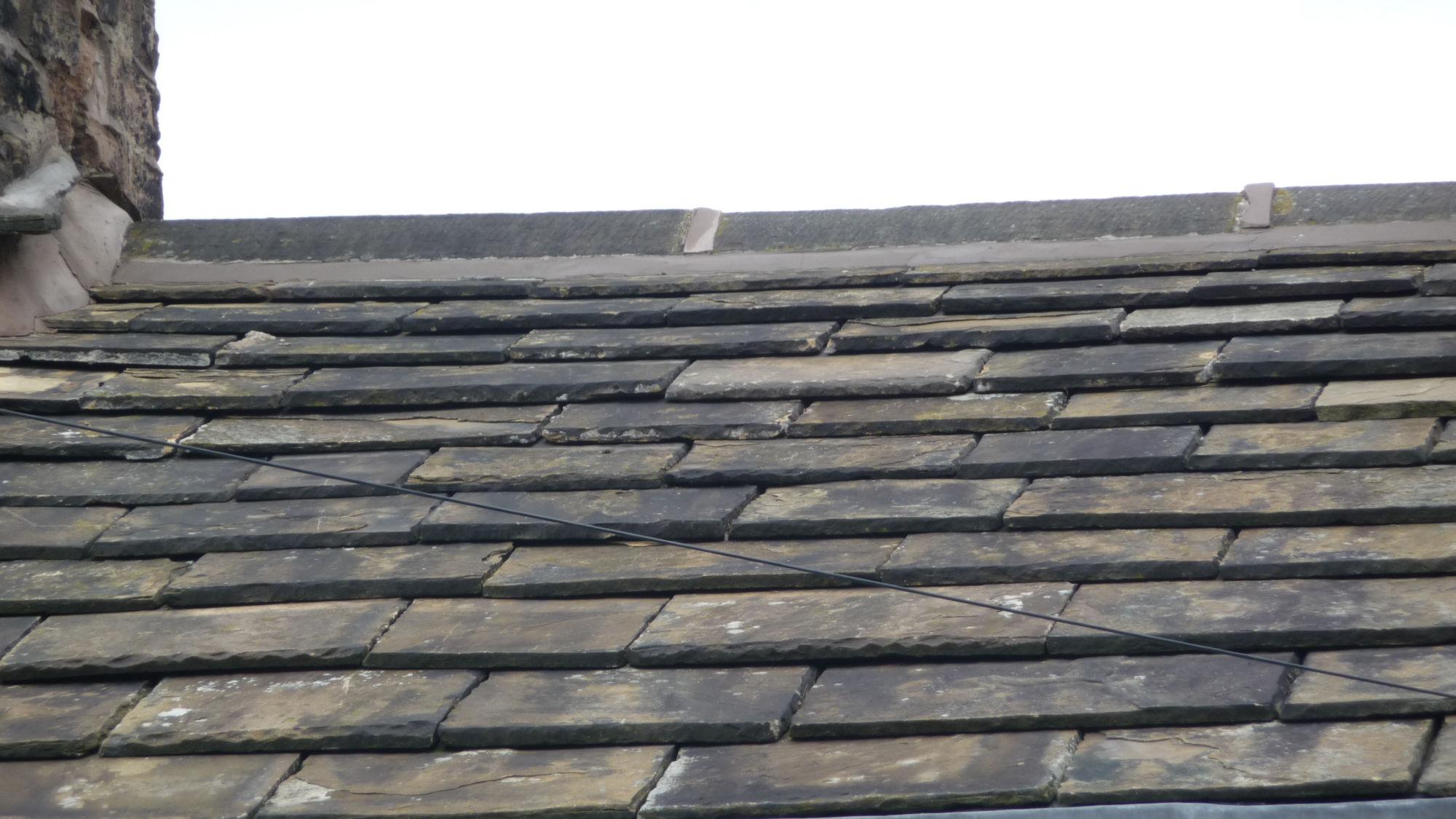 Stone roof ridge tile replacement in Accrington