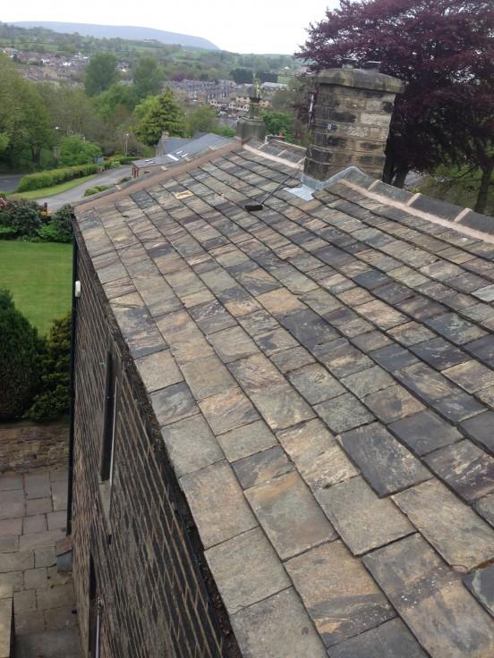 Stone Roof Repair And Ridge Tile Replacement In Burnley